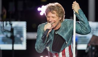 "**FILE** Singer Jon Bon Jovi performs May 18, 2013, on stage as part of his ""Because We Can"" tour in Munich. (Associated Press/dpa, Marc Mueller)"