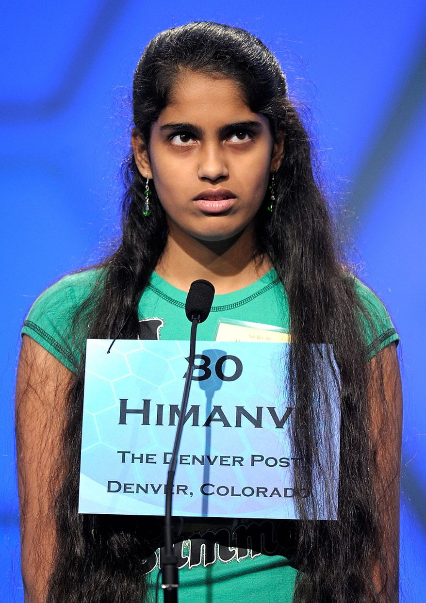 "Himanvi Kopuri, 12 of Denver, spells ""stupefacient"" during the semi-final round of the Scripps National Spelling Bee in Oxon Hill, Md., Thursday, May 30, 2013. (AP Photo/Cliff Owen)"