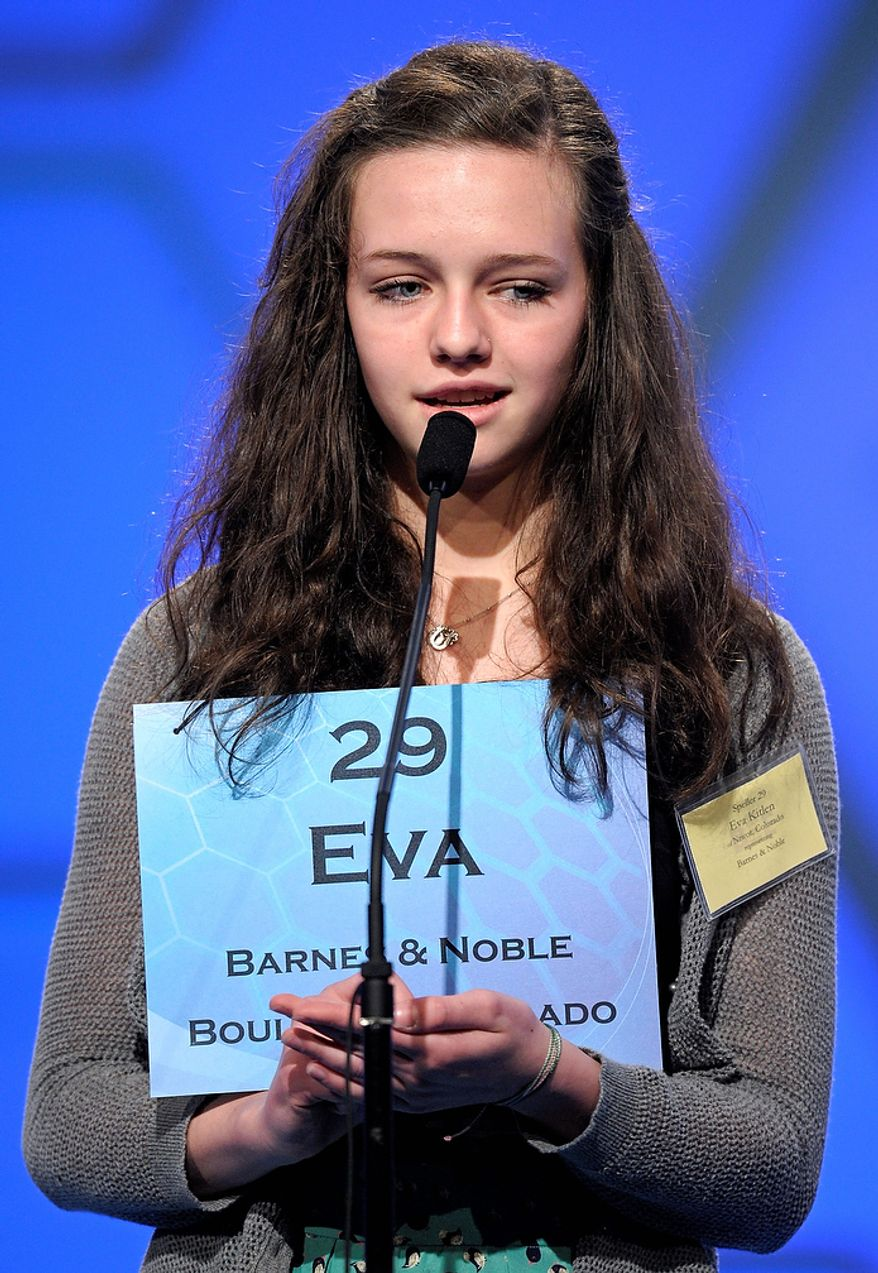 """Eva Kitlen, 14, of Niwot, Colorado  spells """"kleptocrat"""" during the semi-final round of the Scripps National Spelling Bee in Oxon Hill, Md., Thursday, May 30, 2013. (AP Photo/Cliff Owen)"""