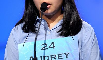 "Audrey Bantug, 13, of San Ramon, California spells ""oread"" during the semi-final round of the Scripps National Spelling Bee in Oxon Hill, Md., Thursday, May 30, 2013. (AP Photo/Cliff Owen)"