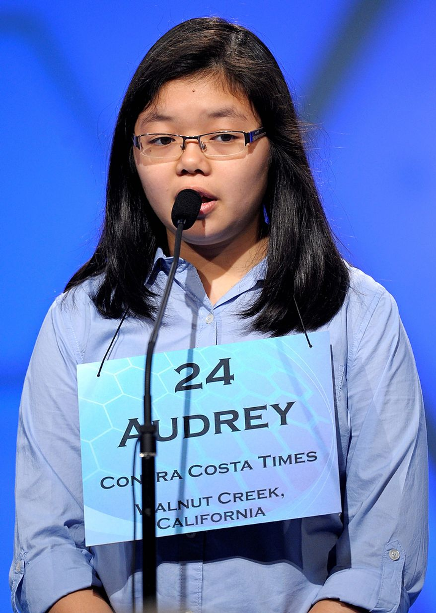 """Audrey Bantug, 13, of San Ramon, California spells """"oread"""" during the semi-final round of the Scripps National Spelling Bee in Oxon Hill, Md., Thursday, May 30, 2013. (AP Photo/Cliff Owen)"""
