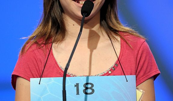 "Isabel Cholbi of San Bernardino, California spells ""telergy"" during the semi-final round of the Scripps National Spelling Bee in Oxon Hill, Md., Thursday, May 30, 2013. (AP Photo/Cliff Owen)"