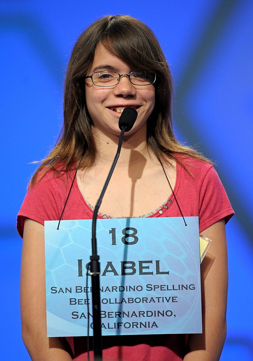 """Isabel Cholbi of San Bernardino, California spells """"telergy"""" during the semi-final round of the Scripps National Spelling Bee in Oxon Hill, Md., Thursday, May 30, 2013. (AP Photo/Cliff Owen)"""