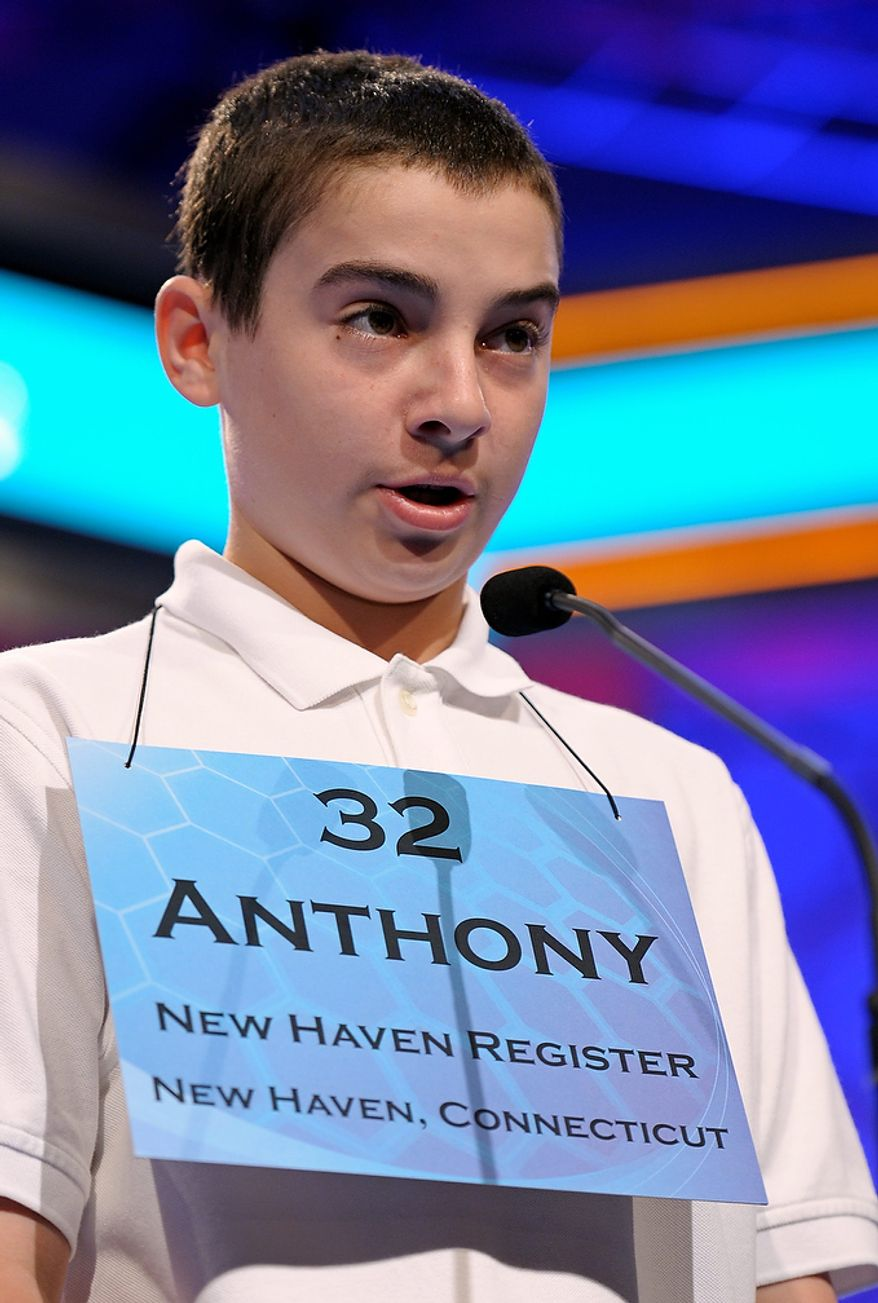 Anthony Constantine, 13, of Milford, Ct.,  spells his word during the second round of the  Scripps National Spelling Bee in Oxon Hill, Md., Wednesday, May 29, 2013. (AP Photo/Cliff Owen)