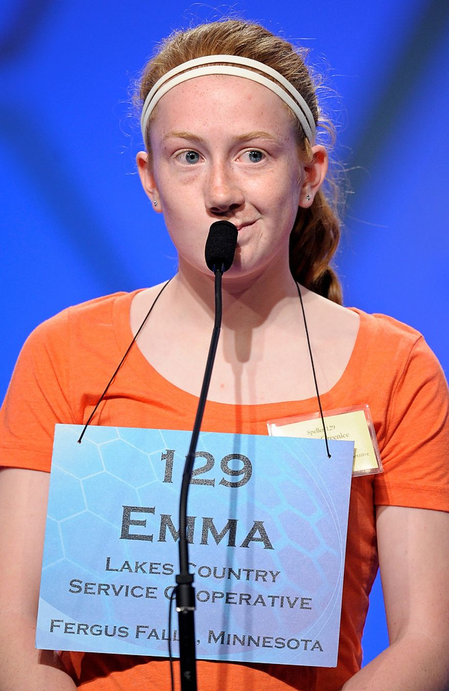 """Emma Greenlee, 14 of Aurora, Minn., spells """"joculator"""" during the semifinal round of the Scripps National Spelling Bee in Oxon Hill, Md., Thursday, May 30, 2013. (AP Photo/Cliff Owen)"""