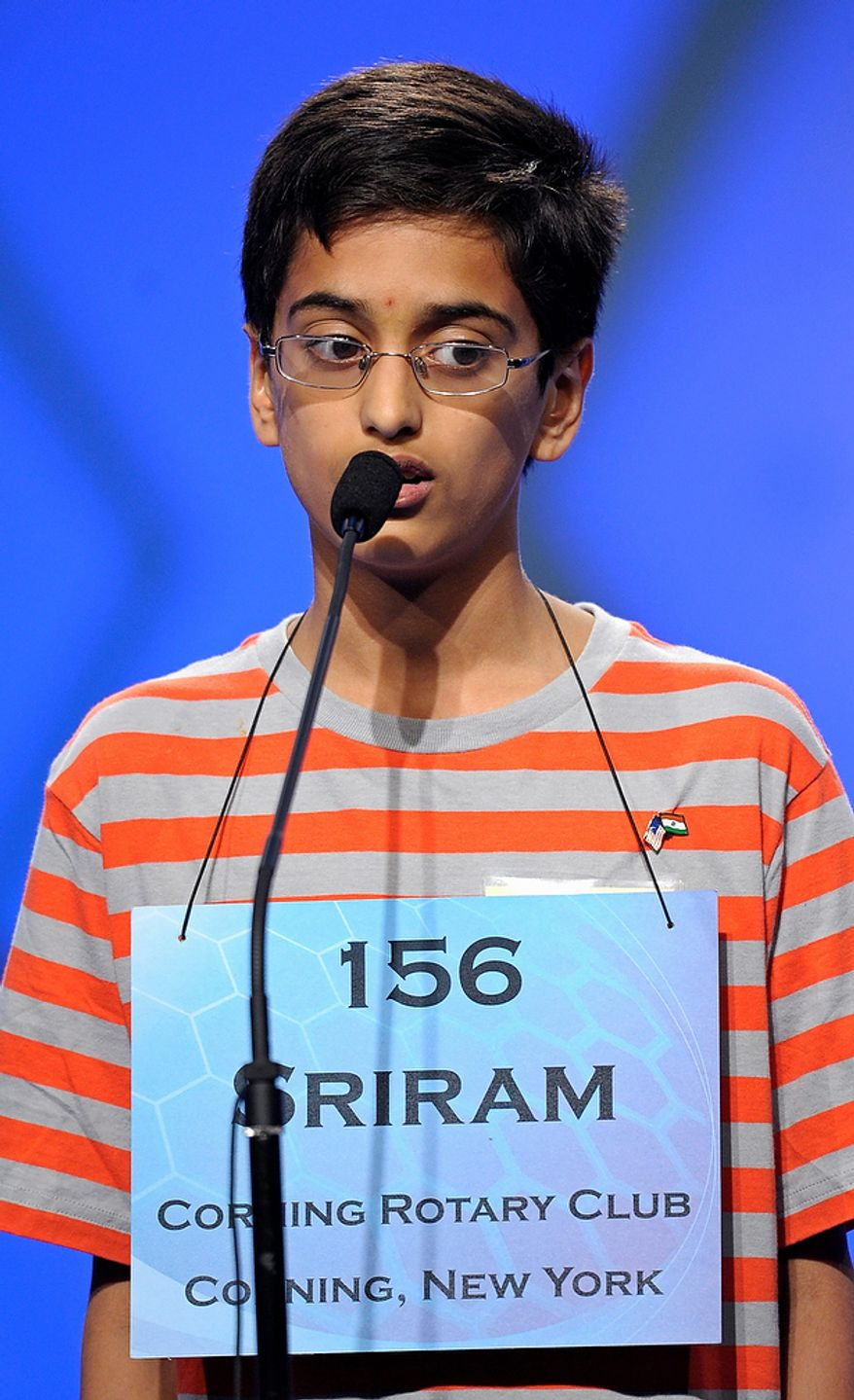 """Sriram Hathwar, 13 of Painted Post, N.Y., spells """"flaneur"""" during the semifinal round of the Scripps National Spelling Bee in Oxon Hill, Md., Thursday, May 30, 2013. (AP Photo/Cliff Owen)"""