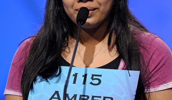"Amber Born, 14 of Marblehead, Mass.,  spells ""pediculicide"" during the semifinal round of the Scripps National Spelling Bee in Oxon Hill, Md., Thursday, May 30, 2013. (AP Photo/Cliff Owen)"