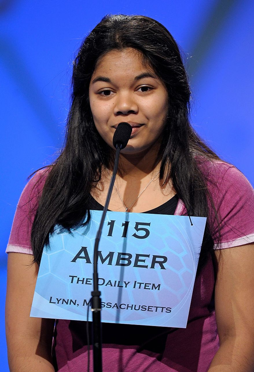 """Amber Born, 14 of Marblehead, Mass.,  spells """"pediculicide"""" during the semifinal round of the Scripps National Spelling Bee in Oxon Hill, Md., Thursday, May 30, 2013. (AP Photo/Cliff Owen)"""