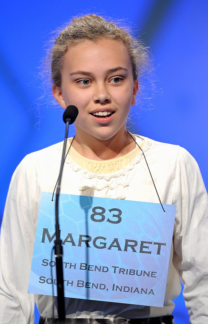 """Margaret Peterson, 13 of Granger, Ind.,  spells """"vecturist"""" during the semifinal round of the Scripps National Spelling Bee in Oxon Hill, Md., Thursday, May 30, 2013. (AP Photo/Cliff Owen)"""