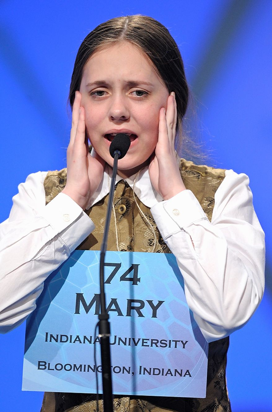 "Mary Skirvin, 13, of Nashville, Ind., incorrectly spells ""laureation"" during the semifinal round of the Scripps National Spelling Bee in Oxon Hill, Md., Thursday, May 30, 2013. (AP Photo/Cliff Owen)"