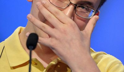 "Mary Skirvin, 14, of Anderson, Ind., incorrectly spells ""ignimbrite"" during the semifinal round of the Scripps National Spelling Bee in Oxon Hill, Md., Thursday, May 30, 2013. (AP Photo/Cliff Owen)"