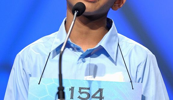 "Ryan Devanandan, 13, of Albany, N.Y.,  spells ""aporia"" during the semifinal round of the Scripps National Spelling Bee in Oxon Hill, Md., Thursday, May 30, 2013. (AP Photo/Cliff Owen)"