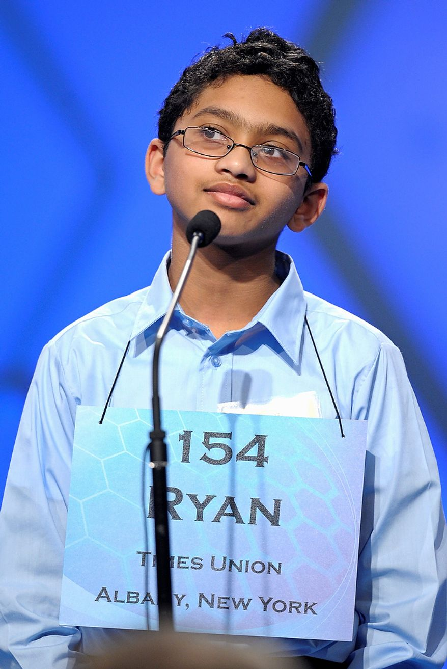 """Ryan Devanandan, 13, of Albany, N.Y.,  spells """"aporia"""" during the semifinal round of the Scripps National Spelling Bee in Oxon Hill, Md., Thursday, May 30, 2013. (AP Photo/Cliff Owen)"""
