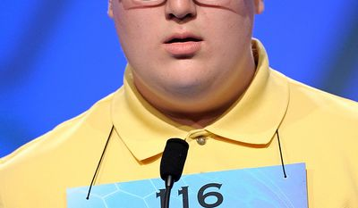 """Matthew Donohue, 14, of Kingston, Mass., incorrectly spells """"diplodocus"""" during the semifinal round of the Scripps National Spelling Bee in Oxon Hill, Md., Thursday, May 30, 2013. (AP Photo/Cliff Owen)"""