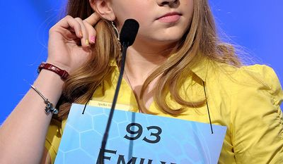 """Emily Keaton, 14, of Pikeville, Ky., spells """"encephalitis"""" during the semifinal round of the Scripps National Spelling Bee in Oxon Hill, Md., Thursday, May 30, 2013. (AP Photo/Cliff Owen)"""