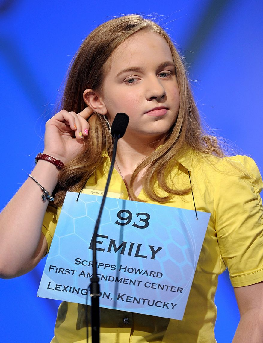 "Emily Keaton, 14, of Pikeville, Ky., spells ""encephalitis"" during the semifinal round of the Scripps National Spelling Bee in Oxon Hill, Md., Thursday, May 30, 2013. (AP Photo/Cliff Owen)"