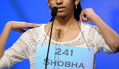 """Shobha Dasari, 12, of Pearland, Texas spells """"spasmolytic"""" during the semifinal round of the Scripps National Spelling Bee in Oxon Hill, Md., Thursday, May 30, 2013. (AP Photo/Cliff Owen)"""