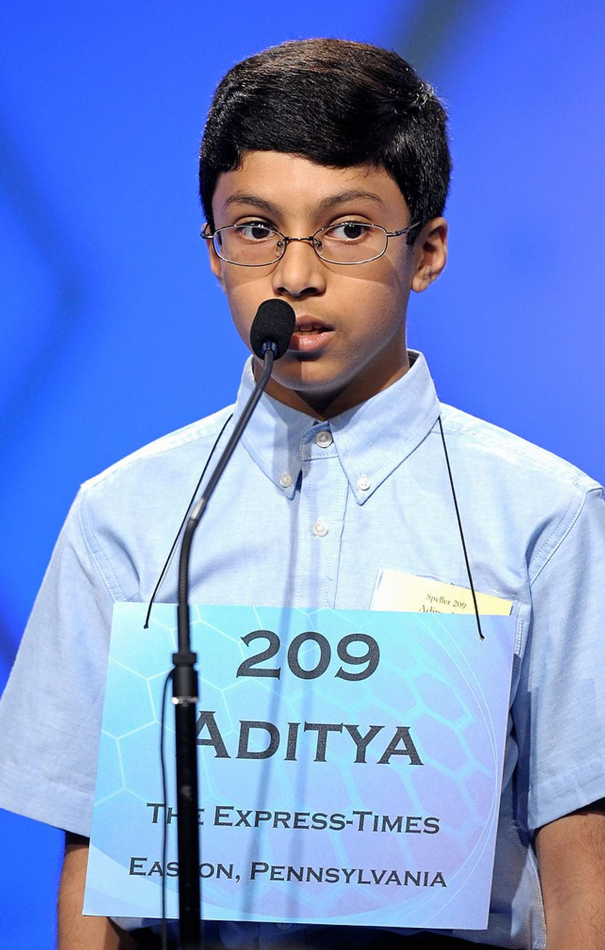 "Aditya Rao, 13, of Phillipsburg, N.J., spells ""tatterdemalion"" during the semifinal round of the Scripps National Spelling Bee in Oxon Hill, Md., Thursday, May 30, 2013. (AP Photo/Cliff Owen)"