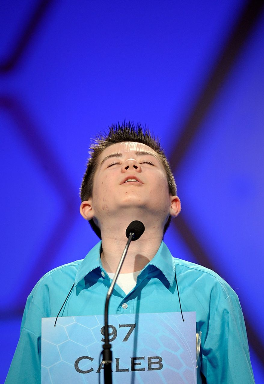 "Caleb Miller, 13, of Calhoun, La., cast his head back after incorrectly spelling ""cyanope'"" during the semifinal round of the Scripps National Spelling Bee in Oxon Hill, Md., Thursday, May 30, 2013. (AP Photo/Cliff Owen)"