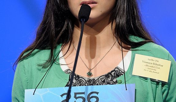 "Syamantak Payra, 14, of Bountiful, Utah, spells ""stultiloquence"" during the semifinal round of the Scripps National Spelling Bee in Oxon Hill, Md., Thursday, May 30, 2013. (AP Photo/Cliff Owen)"