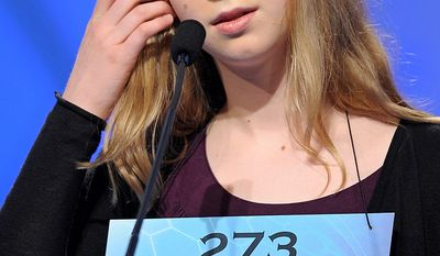 "Sophia Limacher, 13, of Seattle, Wash, incorrectly spells "" morosoph"" during the semifinal round of the Scripps National Spelling Bee in Oxon Hill, Md., Thursday, May 30, 2013. (AP Photo/Cliff Owen)"