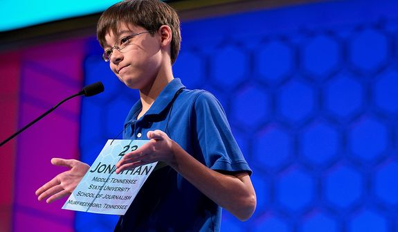 "Jonathan Caldwell, 13, of Hendersonville, Tenn., shrugs his shoulders after getting the word ""pergameneous"" incorrect during the semifinal round of the National Spelling Bee on Thursday, May 30, 2013, in Oxon Hill, Md. (AP Photo/Evan Vucci)"