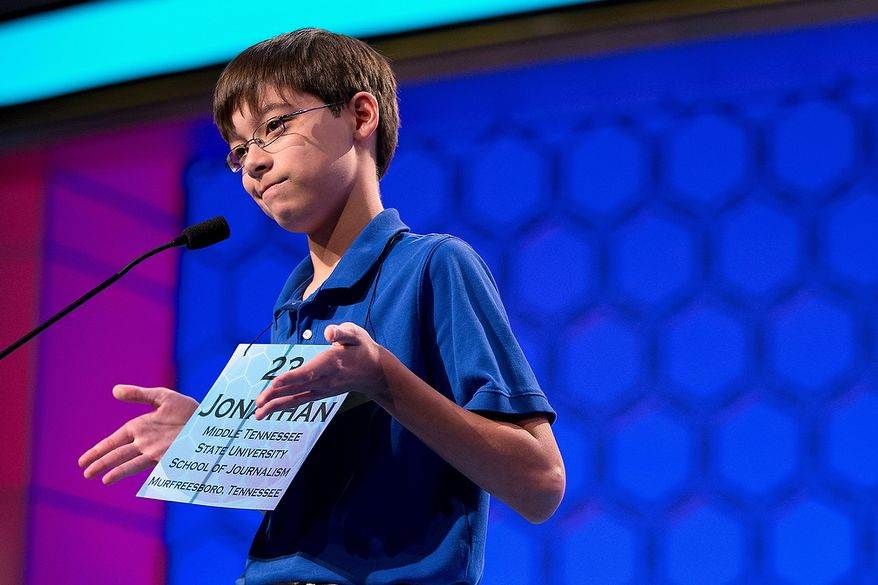 """Jonathan Caldwell, 13, of Hendersonville, Tenn., shrugs his shoulders after getting the word """"pergameneous"""" incorrect during the semifinal round of the National Spelling Bee on Thursday, May 30, 2013, in Oxon Hill, Md. (AP Photo/Evan Vucci)"""