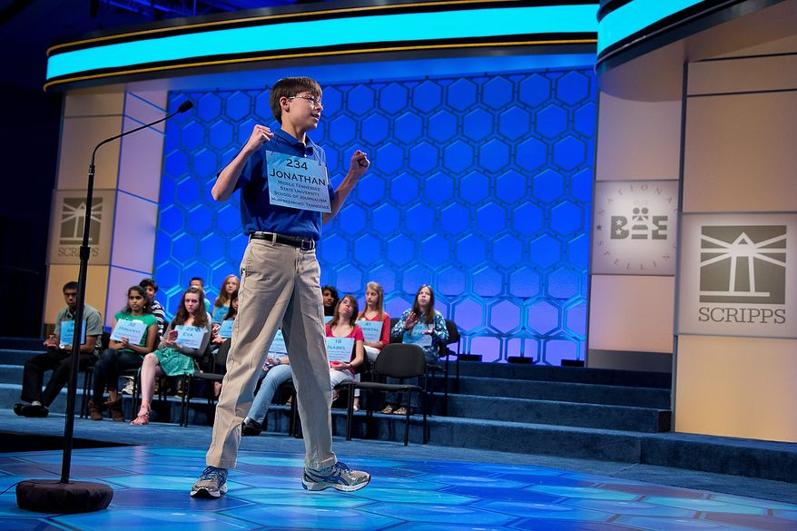 """Jonathan Caldwell, 13, of Hendersonville, Tenn., reacts after spelling the word """"persiflage"""" correctly during the semifinal round of the National Spelling Bee, Thursday, May 30, 2013, in Oxon Hill, Md. (AP Photo/Evan Vucci)"""