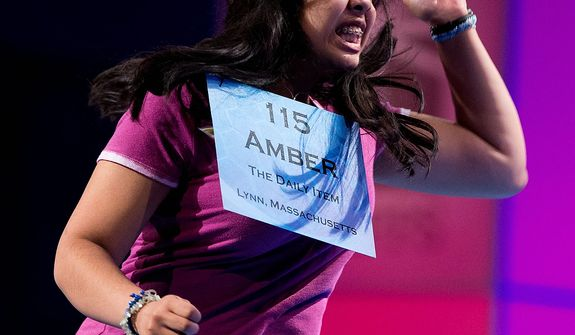 "Amber Born, 14 of Marblehead, Mass. reacts after spelling the word ""malacophilous"" correctly during the semifinal round of the National Spelling Bee, Thursday, May 30, 2013, in Oxon Hill, Md. (AP Photo/Evan Vucci)"