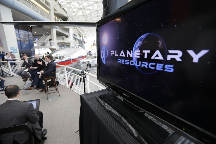 **FILE** Officials with Planetary Resources, an asteroid mining company based in Bellevue, Wash., talk to reporters May 29, 2013, in Seattle about their plans for the world's first crowd funded space telescope. (Associated Press