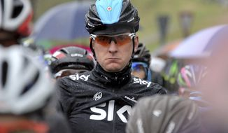 FILE - In this Thursday, May 16, 2013 file photo, Britain's Bradley Wiggins waits at the start of the 12th stage of the Giro d'Italia, Tour of Italy cycling race, from Longarone to Treviso. Team Sky said Friday, May 31, 2013 that defending champion Bradley Wiggins will not race in Tour de France cycling race due to illness and injury. (AP Photo/Gian Mattia D'Alberto, File)