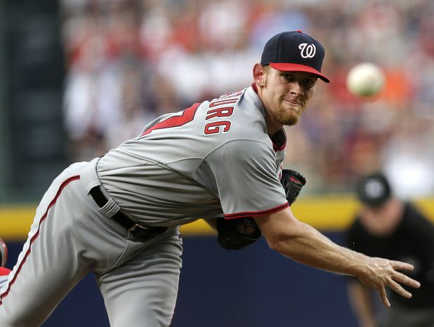 Washington Nationals right-hander Stephen Strasburg was pulled from Friday night's game against the Atlanta Braves after two innings with apparent injury. (Associated Press photo)