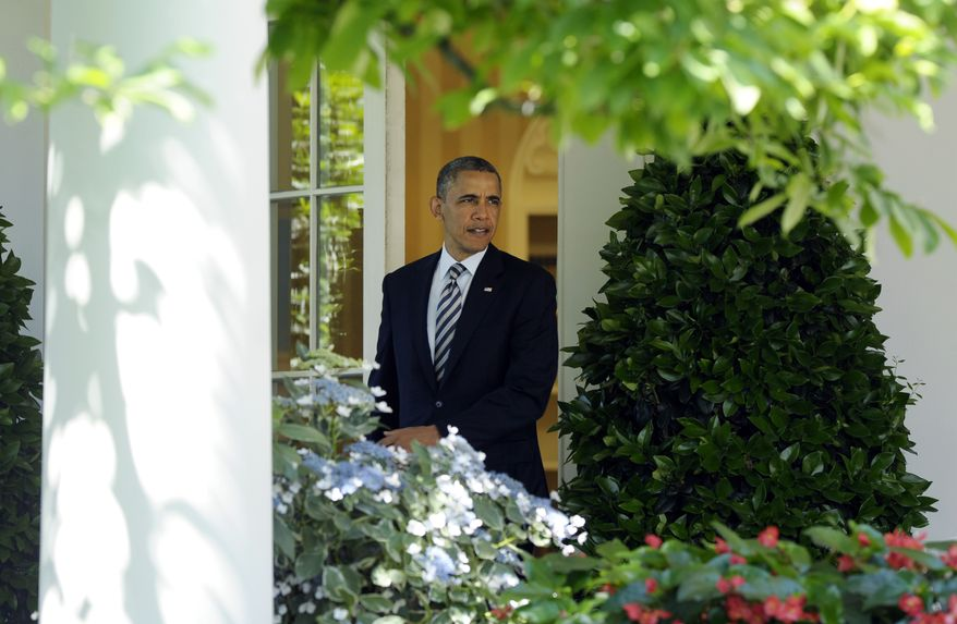 President Obama walks out of the Oval Office of the White House in Washington on May 31, 2013. (Associated Press)