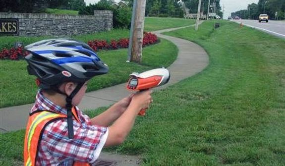 ** FILE ** A boy uses a Hot Wheels brand toy radar gun in Louisville, Ky. (Associated Press)