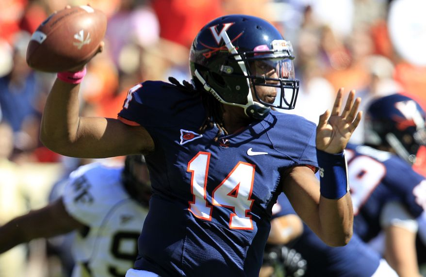 """FILE - In this Oct. 20, 2012 file photo, Virginia quarterback Phillip Sims (14) prepares to pass during the first half of an NCAA college football game against Wake Forest at Scott Stadium in Charlottesville, Va. Sims' time at Virginia is finished. The heralded transfer from Alabama is ineligible to play and will leave the university after completing his current summer school session, coach Mike London announced Friday, May 31, 2013. London said in a statement released by the school that """"Phillip did not make the commitment he needed to succeed here.""""(AP Photo/Steve Helber, File)"""