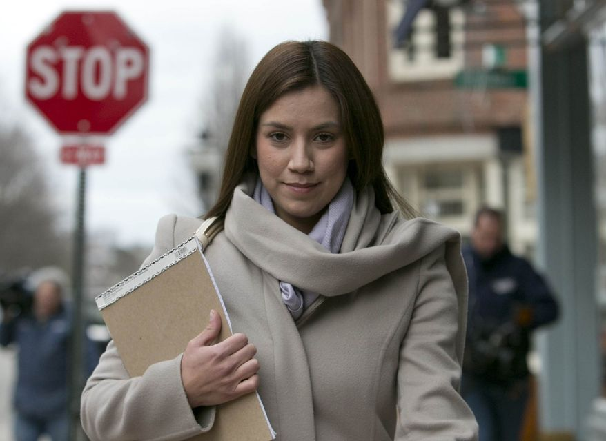 ** FILE ** In this March 13, 2013, file photo, Alexis Wright, 30, leaves the Cumberland County Courthouse in Portland, Maine. (AP Photo/Robert F. Bukaty, File)
