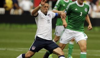 U.S. forward Clint Dempsey (8) and Germany midfielder Stefan Reinartz (3) go for the ball during the first half of an international friendly soccer match at RFK Stadium Sunday, June 2, 2013, in Washington. (AP Photo/Alex Brandon)