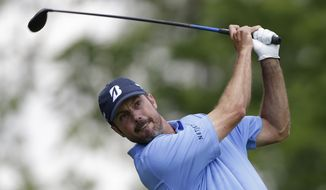 Matt Kuchar tees off the third hole during the final round of the Memorial golf tournament on Sunday, June 2, 2013, in Dublin, Ohio. (AP Photo/Darron Cummings)