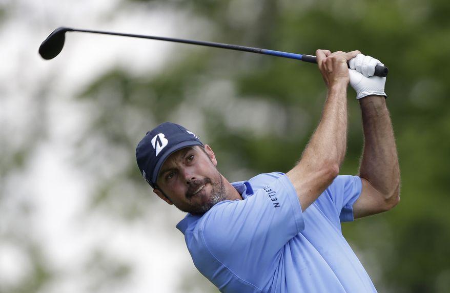 Matt Kuchar tees off the third hole during the final round of the Memorial golf tournament on Sunday, June 2, 2013, in Dublin, Ohio. (AP Photo/Darron Cummings)