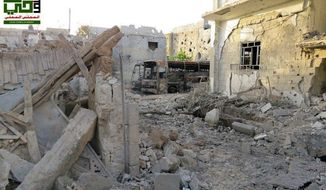 Homes destroyed by government airstrikes and shelling in the Barzeh district of Damascus, Syria, on Saturday, June 1, 2013, are pictured in a citizen journalist image provided by the Local Council of Barzeh and authenticated based on its contents and other AP reporting. (AP Photo/Local Council of Barzeh)