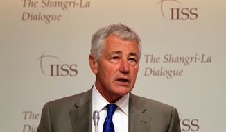 "U.S. Defense Secretary Chuck Hagel prepares to deliver his keynote address on ""The U.S. Approach to Regional Security"" at the International Institute for Strategic Studies Shangri-la Dialogue, or IISS Asia Security Summit, in Singapore on Saturday, June 1, 2013. (AP Photo/Wong Maye-E)"
