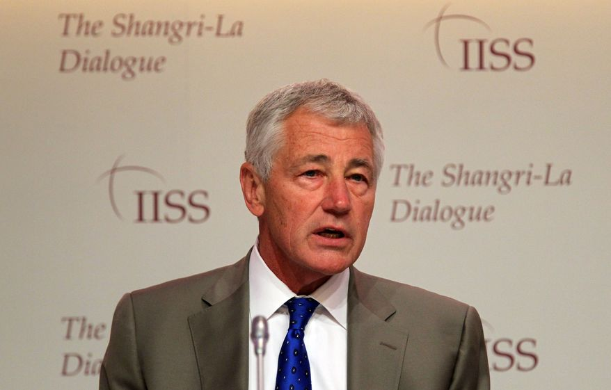 """U.S. Defense Secretary Chuck Hagel prepares to deliver his keynote address on """"The U.S. Approach to Regional Security"""" at the International Institute for Strategic Studies Shangri-la Dialogue, or IISS Asia Security Summit, in Singapore on Saturday, June 1, 2013. (AP Photo/Wong Maye-E)"""