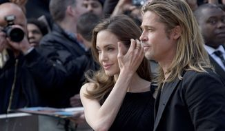 """Actors Angelina Jolie and Brad Pitt arrive for the world premiere of the film """"World War Z,"""" in which Mr. Pitt stars, at a central London cinema on Sunday, June 2, 2013. (Joel Ryan/Invision/AP)"""