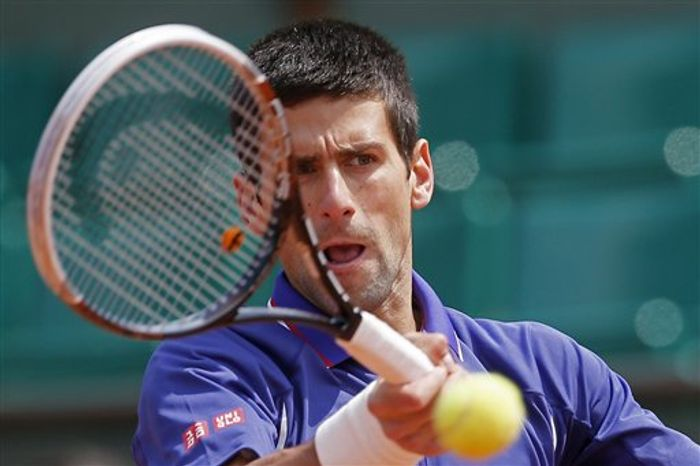 Serbia's Novak Djokovic returns against Germany's Philipp Kohlschreiber in their fourth round match at the French Open tennis tournament, at Roland Garros stadium in Paris, Monday June 3, 2013. (AP Photo/Michel Spingler)