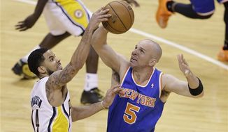 Indiana Pacers guard D.J. Augustin, left, blocks the shot of New York Knicks guard Jason Kidd during the second half of Game 4 of the Eastern Conference semifinal NBA basketball playoff series in Indianapolis, Tuesday, May 14, 2013. (AP Photo/Michael Conroy)