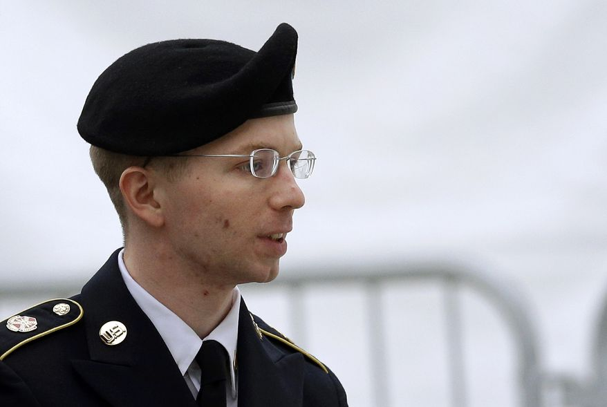 ** FILE ** Army Pfc. Bradley Manning is escorted into a courthouse at Fort Meade, Md., before a pretrial military hearing on Tuesday, May 21, 2013. (AP Photo/Patrick Semansky)