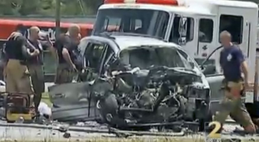 "In this image taken from video, emergency personnel work the scene of a car crash Friday, May 31, 2013, in Jonesboro, Ga. Former NBA All-Star guard Daron ""Mookie"" Blaylock's SUV crossed the center line and crashed head-on into a van in suburban Atlanta, police said.  (AP Photo/WSB-TV)"