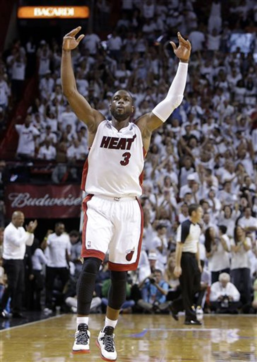 Miami Heat shooting guard Dwyane Wade (3) celebrates a basket during the second half of Game 7 in their NBA basketball Eastern Conference finals playoff series against the Indiana Pacers, Monday, June 3, 2013 in Miami. (AP Photo/Lynne Sladky)