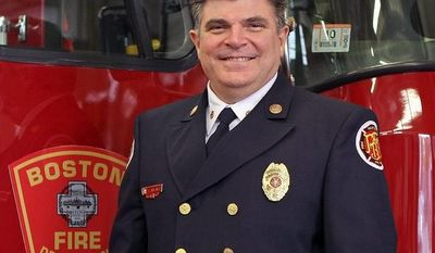 In this Nov. 16, 2011, photo, Boston Fire Chief Steve Abraira poses for a photo at a fire station in Boston. In a letter dated Monday, June 3, 2013, Abraira said he is resigning effecting on Friday, saying public criticism from his deputies for the way he responded to the marathon bombings has made it impossible for him to do his job. (AP Photo/Boston Herald, Mark Garfinkel)