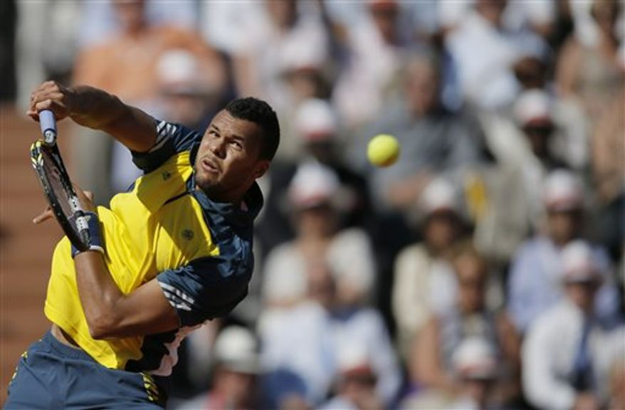 France's Jo-Wilfried Tsonga returns the ball to Switzerland's Roger Federer during their quarterfinal match of the French Open tennis tournament at the Roland Garros stadium Tuesday, June 4, 2013 in Paris. (AP Photo/Petr David Josek)